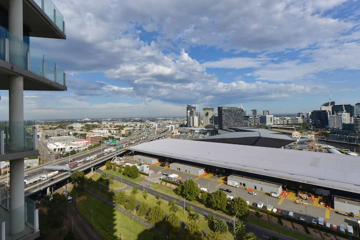 Unobscured view from living room across Melbourne toward Port Phillip Bay - Convention and Exhibition Centre in the foreground