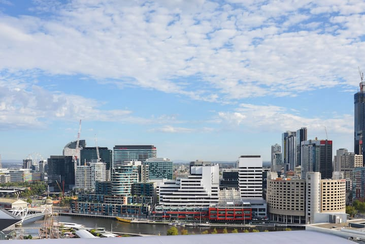 Unobscured views across Melbourne overlooking convention and exhibitional Centre towards Geelong from apartment building