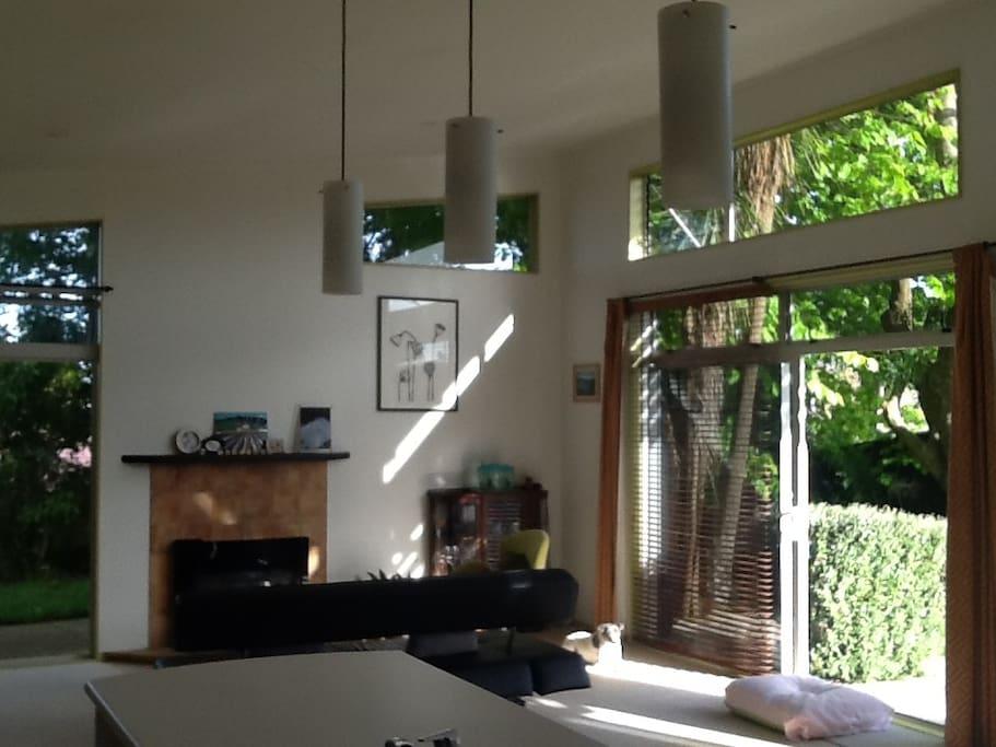 Modern high ceiling house has lots of sun lights