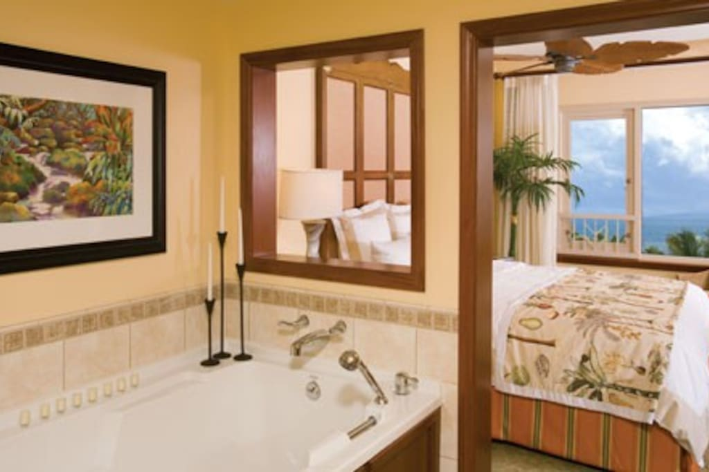 Privacy of the master bedroom and bath still affords a view.