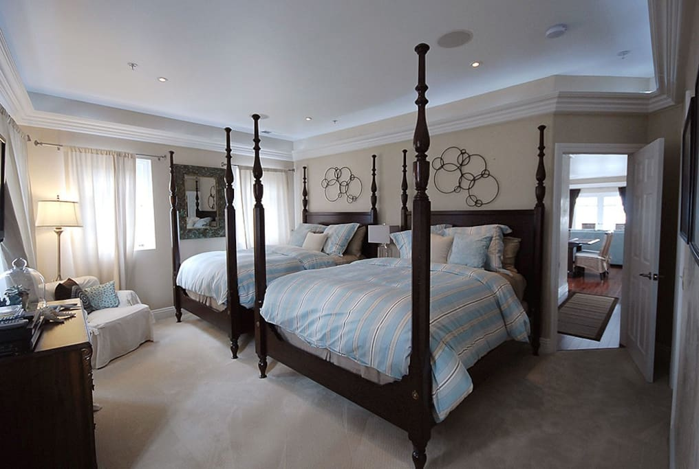 One bedroom suite with two poster queen beds