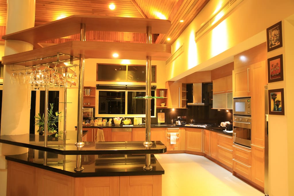 Kitchen with all SMEG and Siemens appliances, along with granite bench tops.