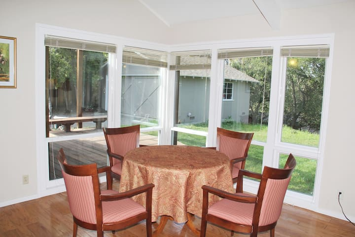 A place to comfortably sit, dine, and enjoy the view to an expansive backyard