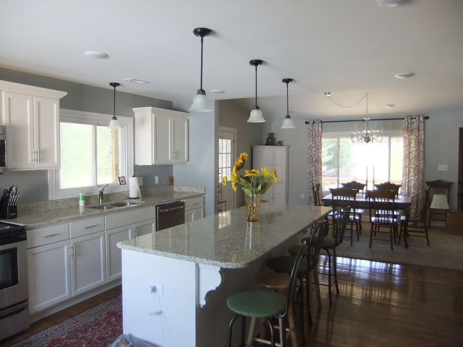 Fully equipped kitchen with island, bar stools and granite countertops