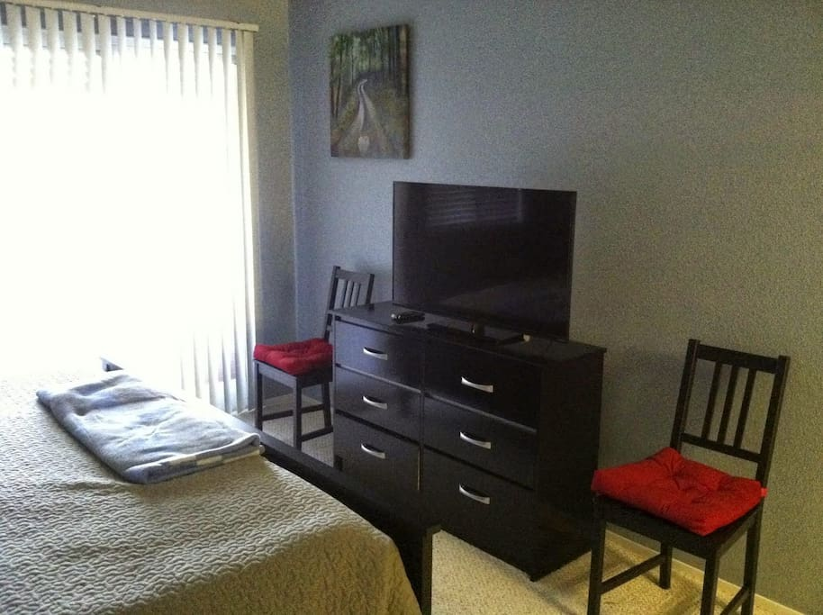 Master bedroom flat screen TV with available internet connection to stream movies and with basic cable TV