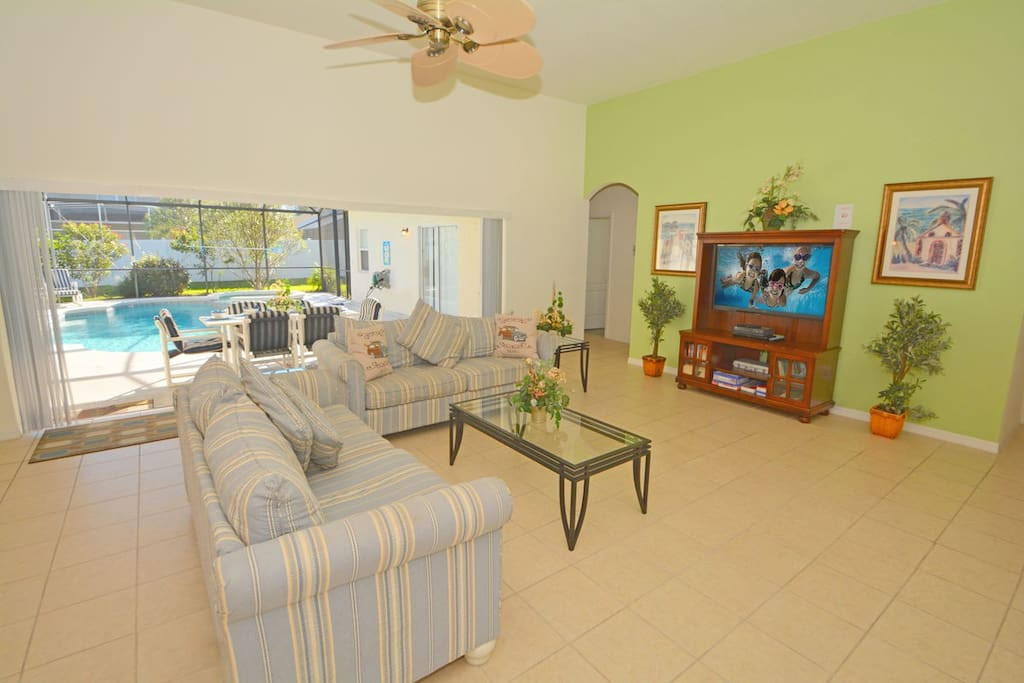 Family TV room with pocket sliding doors for beautiful views of pool area