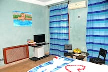 Double Room with private bathroom TV and sitting area