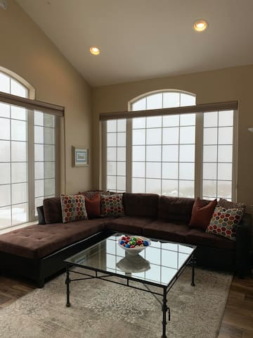 Front room area with a sectional, leather recliner, flat screen tv and a DVD player too!  Amazing views of the Sierra mountains and Valley views.
