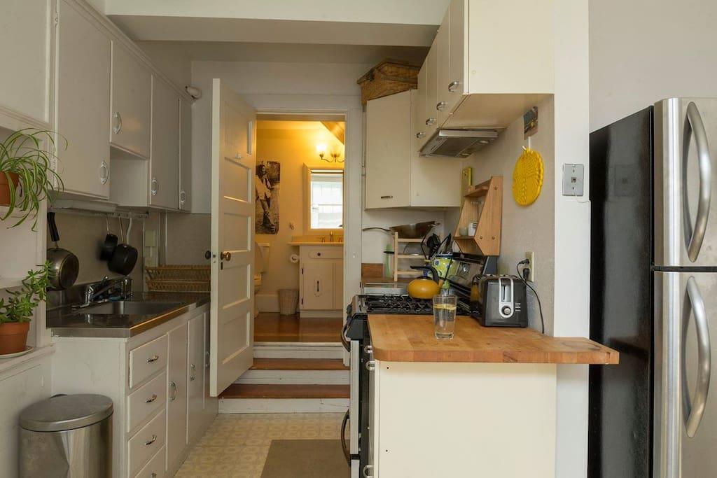 kitchen into bathroom