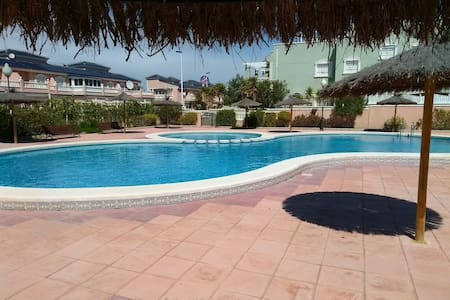 Sunny apartment - pool, private sundeck & parking