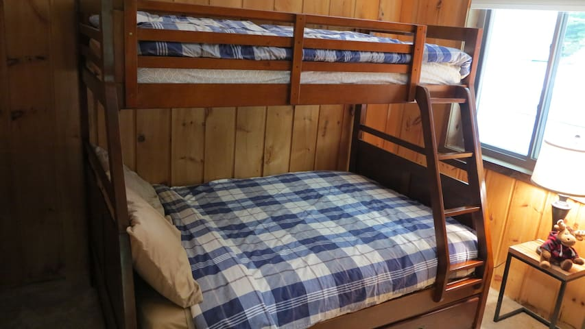 Second bedroom with full bed and twin