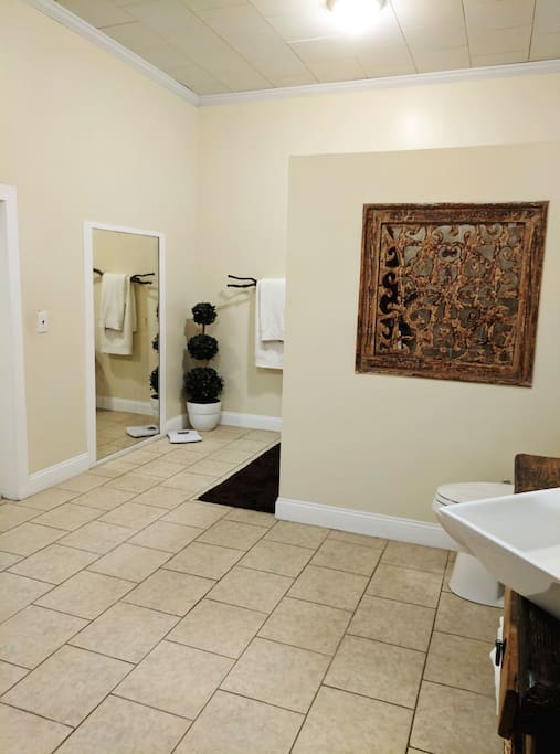 Shared bathroom with walk-in shower