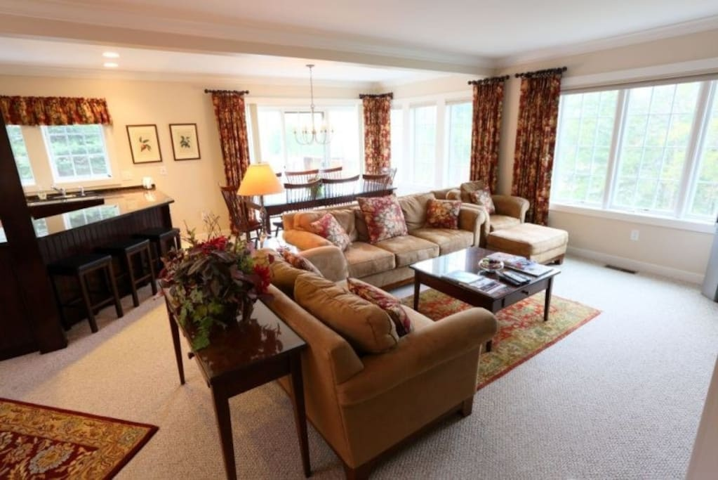 Ample living room seating around fireplace and Entertainment center