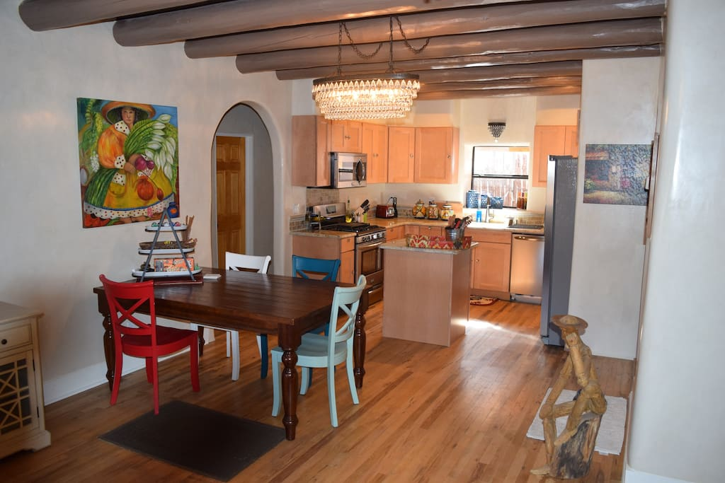 Living kitchen area is open and totally renovated.