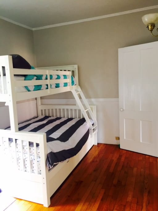 Bedroom with bunk beds (one twin and one full) plus a trundle bed.