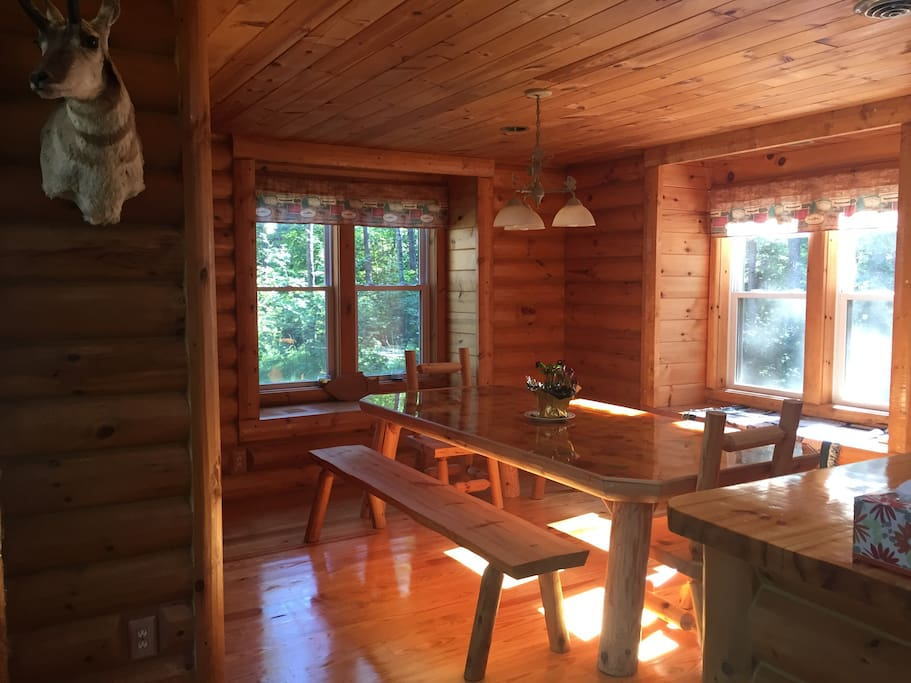 Custom kitchen table comfortably seats 6-8 people with beautiful views of the natural surroundings.