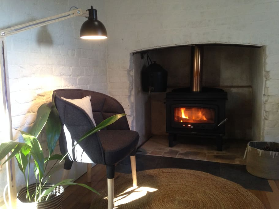 Woodheater makes it a cosy space (with backup electric heating)