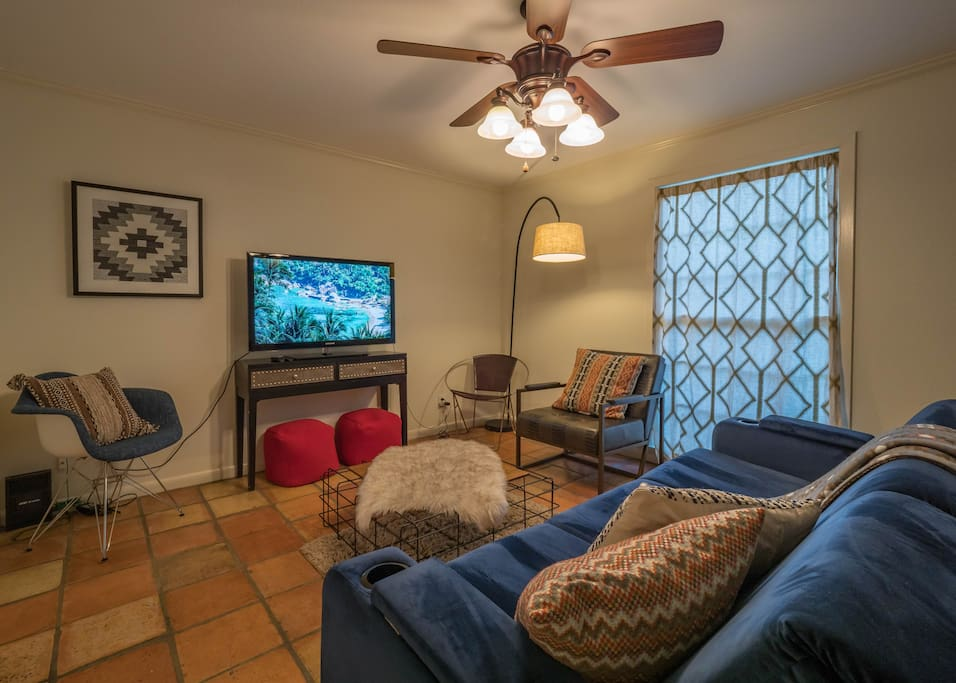 Living Room with Smart TV, Pullout Sofa, and Plenty of Seating