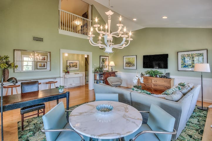 Dining for 4 under chandelier lighting plus nearby workspace
