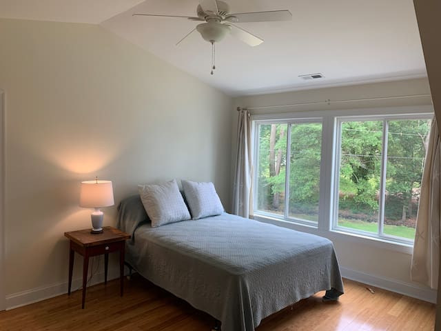 Ensuite master bedroom in upstairs apartment with  water views