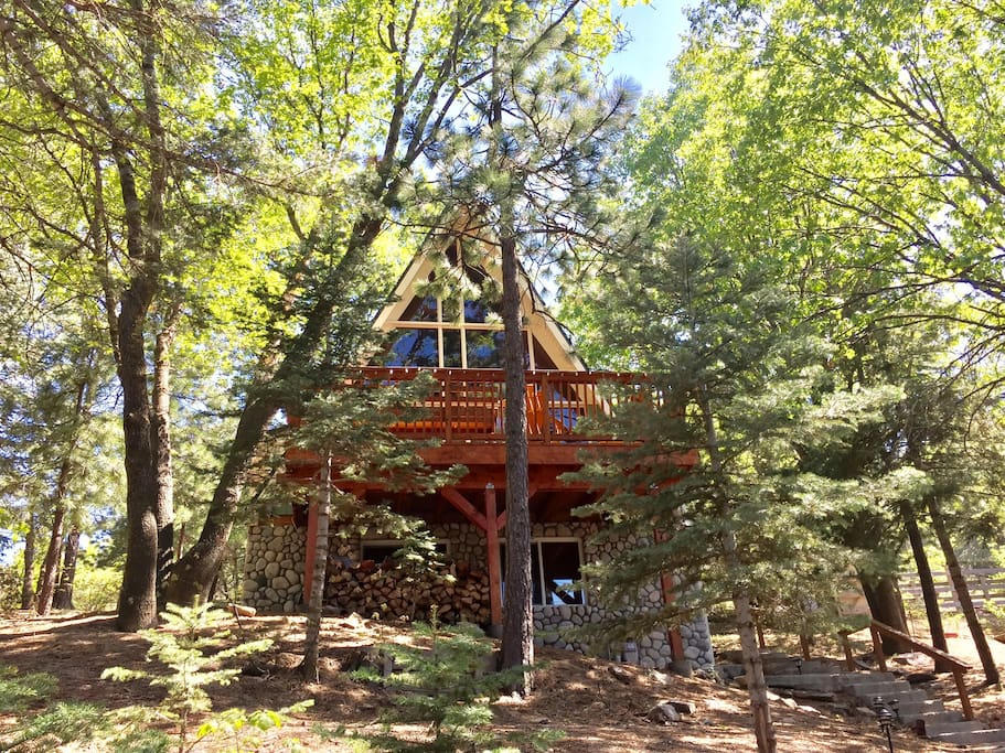 """A-Frame with """"Tree house"""" style deck and fire pit"""