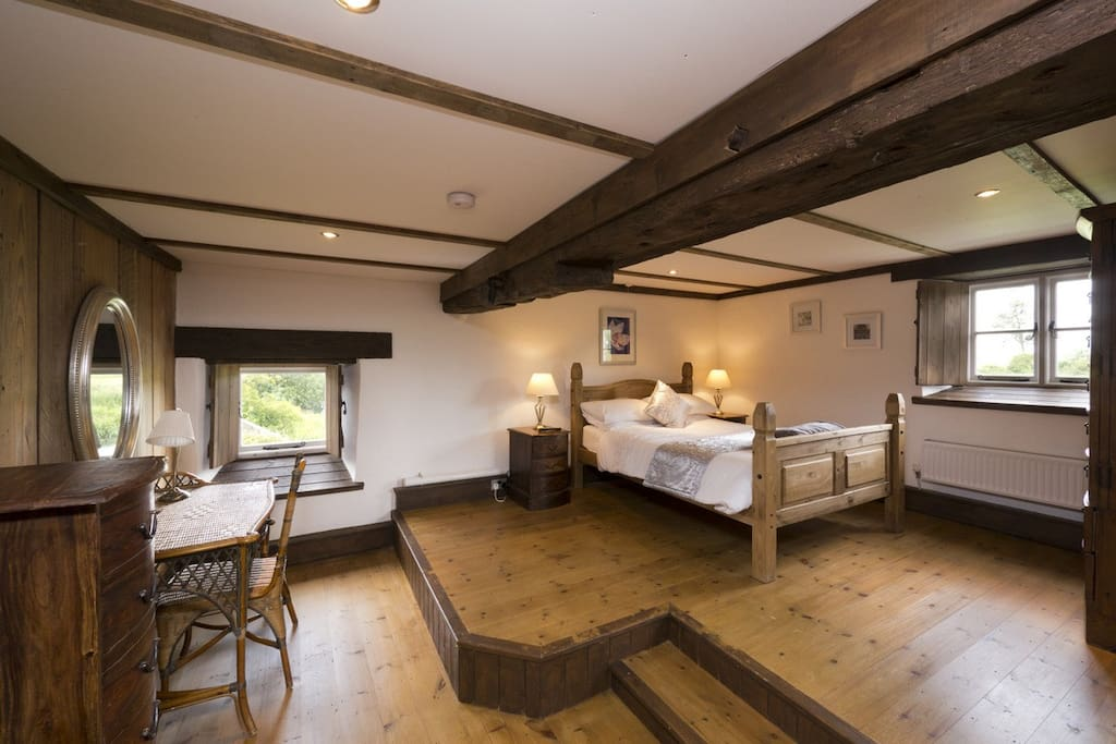 The master bedroom has an en suite and overhangs the river!
