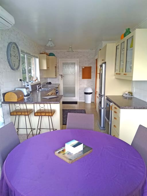 Kitchen with new stainless appliances and heatpump