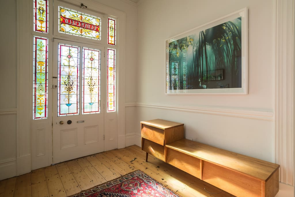 The foyer with stained glass front door