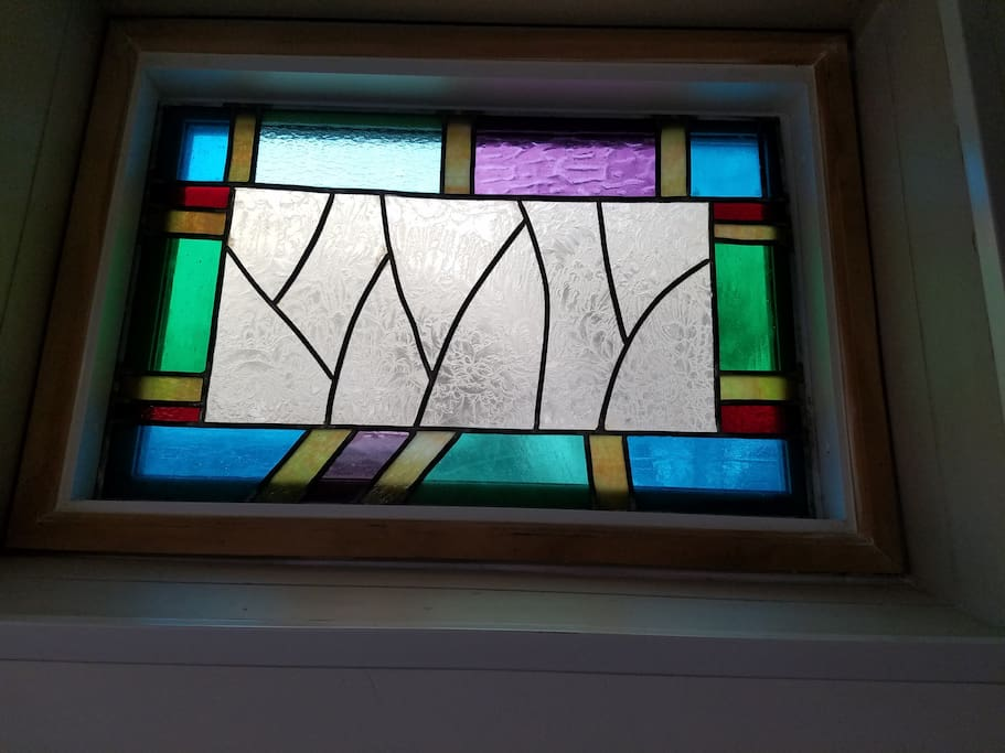 Stained glass window in bedroom