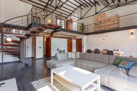 Modern loft in the heart of the village
