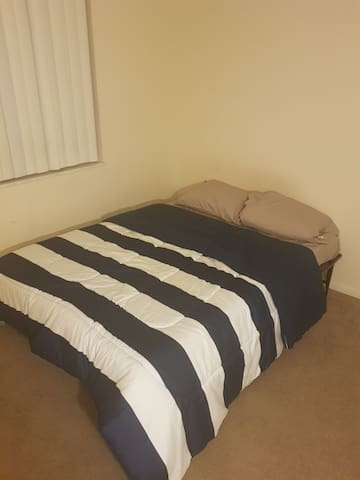 1 bedroom with a full-size bed