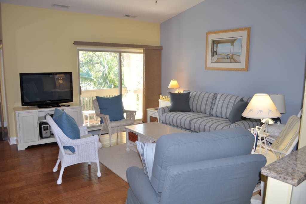 Bright and spacious living room has a flat screen TV & DVD player.