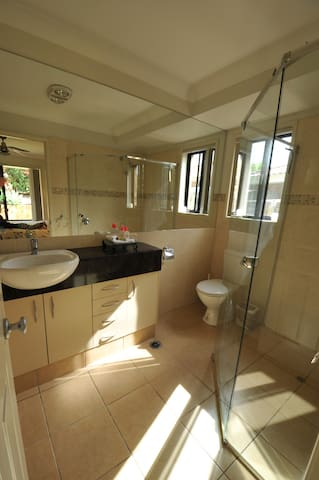 Ensuite with shower, toilet and sink