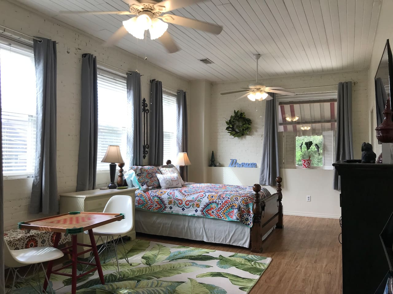 The master suite features a new Queen bed with euro top mattress.  The space is light filled and shows a lovely second story view of the town and live oak trees.  When you are ready to settle, pull the black out curtains close) now in every bedroom)