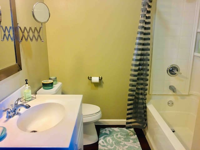 Full bathroom with a tub, a modern shower head. body wash, shampoo and hair conditioner are always provided.