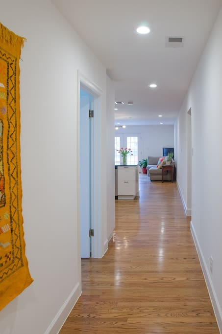 The entry to the home is private and bright, with hardwood floors, bright walls and colorful accents, including a hand-woven saffron yellow rug we brought back from Morocco.