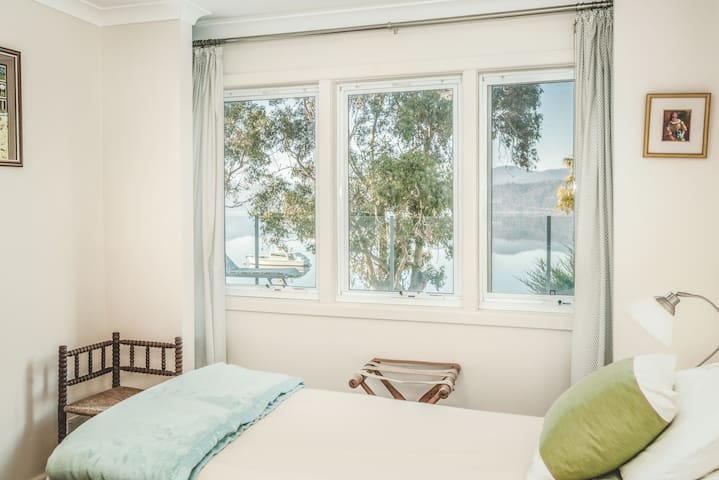 Down stairs bedroom can be configured as 2 x singles or 1 x king bed.  View of the river