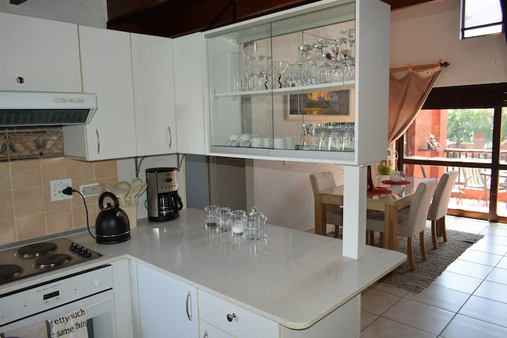 Lovely, sunny African style two bed loft apartment