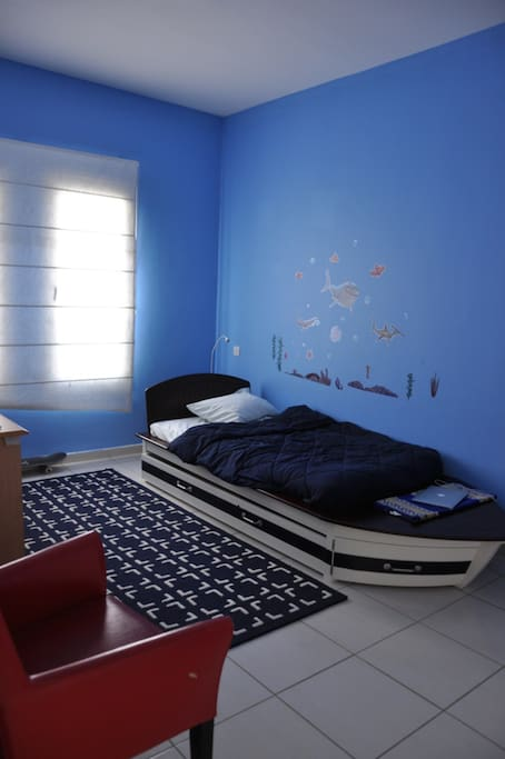 Kids bedroom with single bed and floor mattress. Sleeps 2 kids or medium size adults