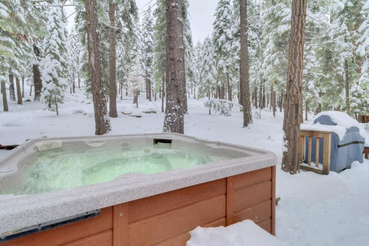 Hot tub on the back deck with relaxing view into the forest