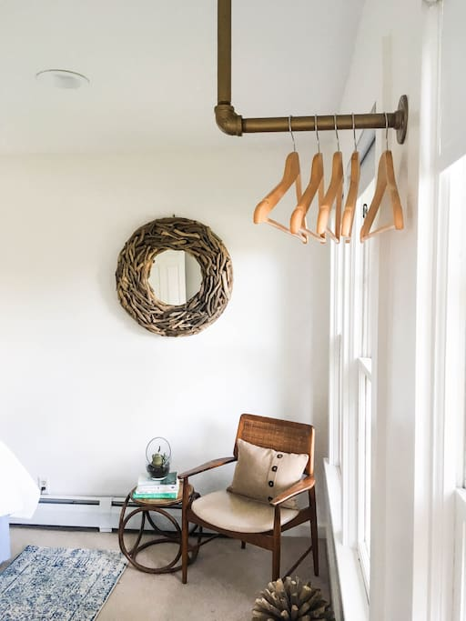 Bright reading nook and retro clothing rack
