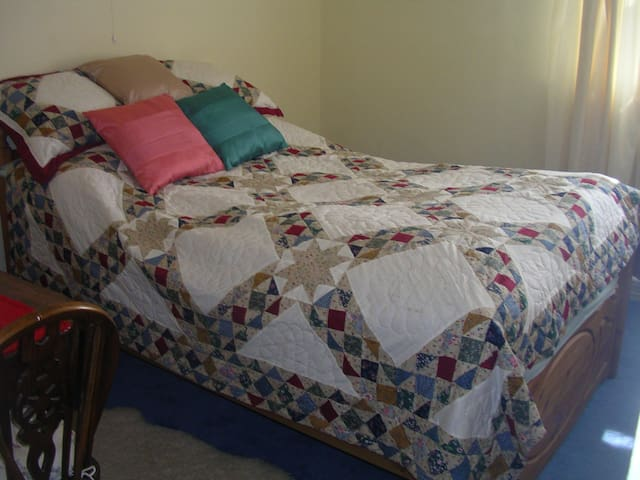 Standard double bed - south facing bedroom.