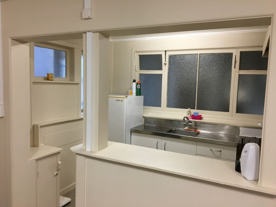 Kitchenette with sink and fridge.