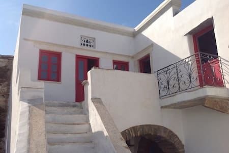 Restored traditional stone house with pebble yard - Tinos