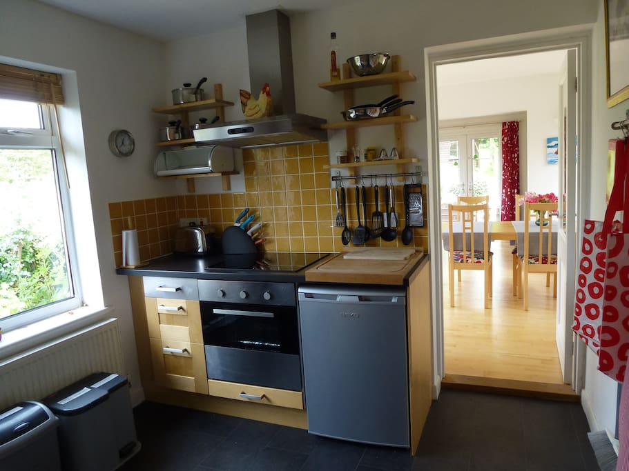 Kitchen with fridge, dishwasher, washing machine, microwave and conventional oven.