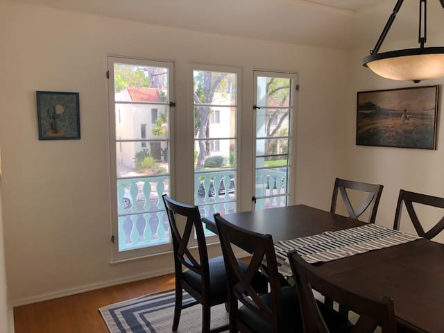 Formal dining area opens to large balcony