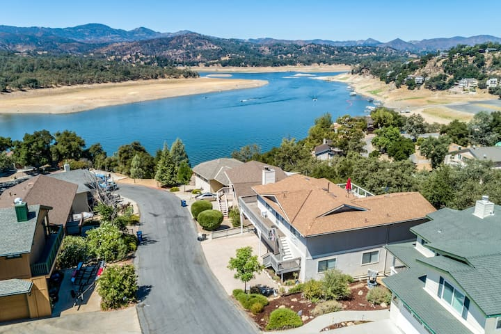 Enjoy lake views from living room or redwood deck, shared pool!