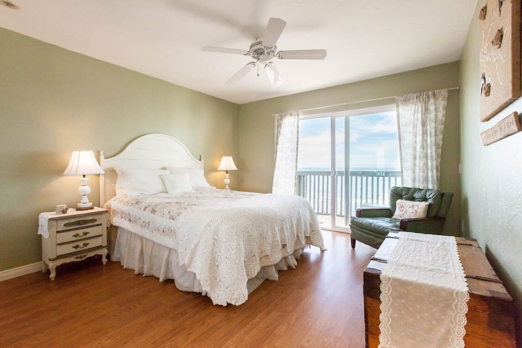 Beautiful master bedroom with view, a queen bed and sliding doors to the deck.