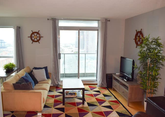 Spacious living room w/ TV & access to Chromecast.  Private balcony off of the living room.