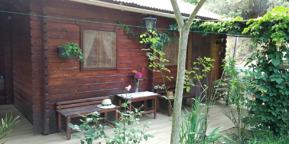 Habitación Studio & Suite en casa de madera.